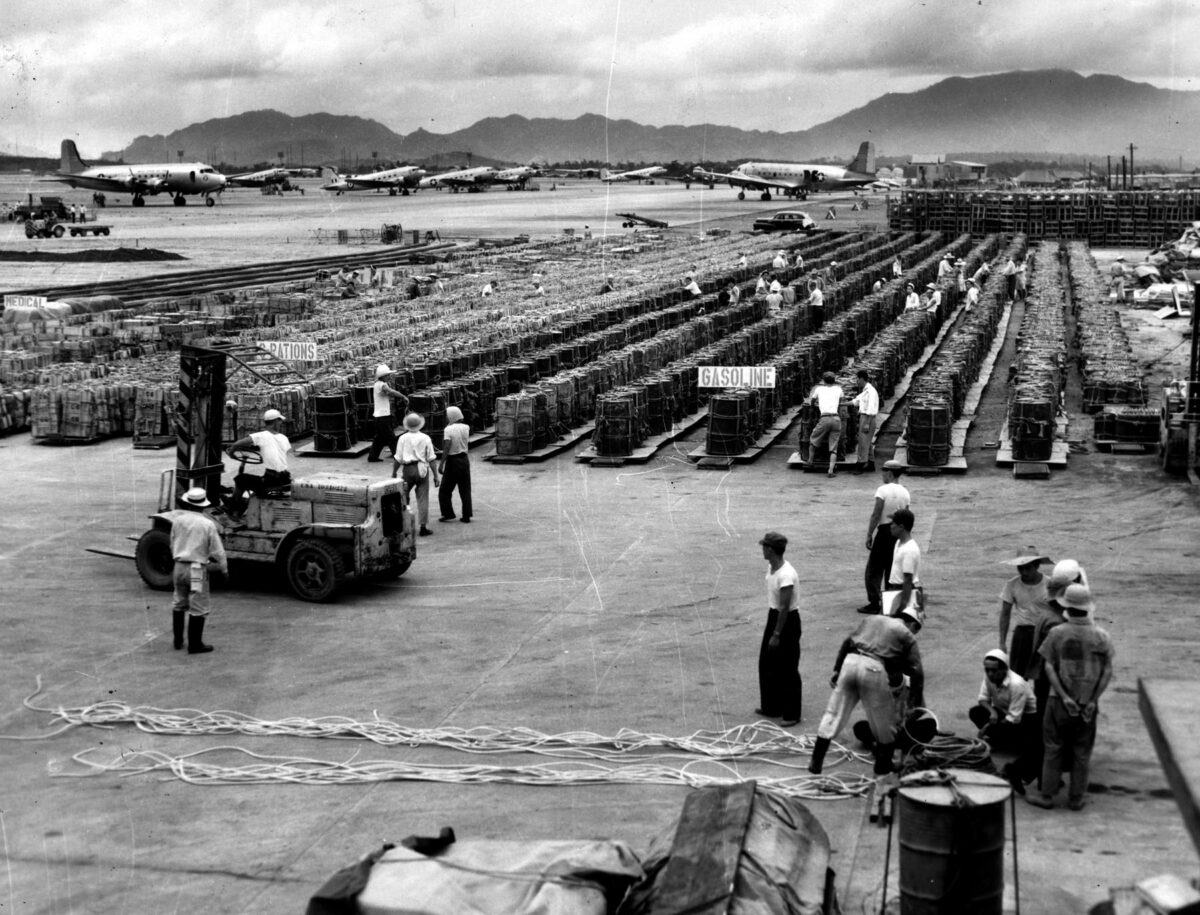 A sea of supplies at an airbase in Japan stands ready for loading into C-119 Flying Boxcars for delivery to front-line areas in Korea. (Photo: U.S. Air Force)