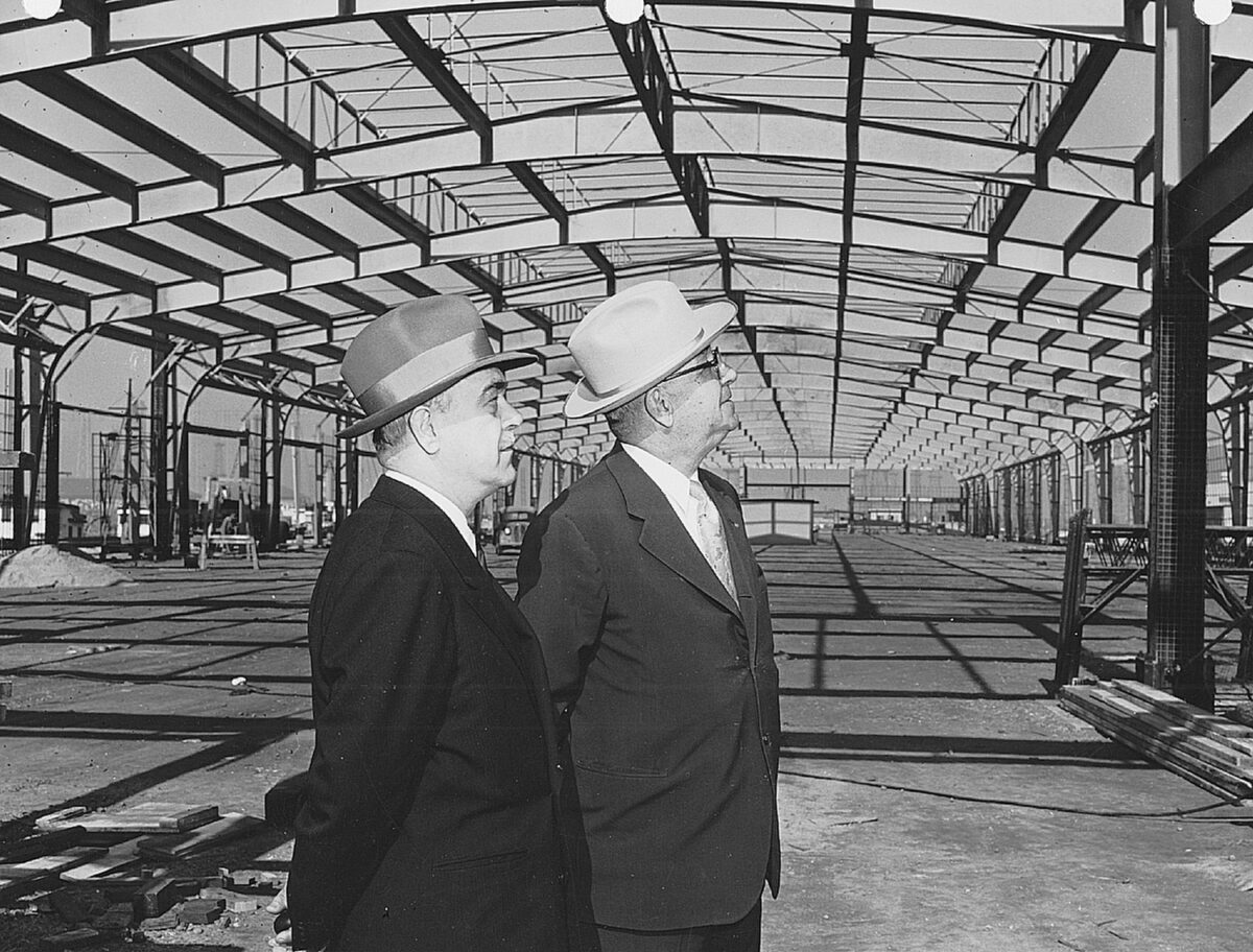 Harbor Commissioner John Davis and Port General Manager Eloi Amar inspect a new transit shed in 1954.  (Photo: Port of Long Beach)