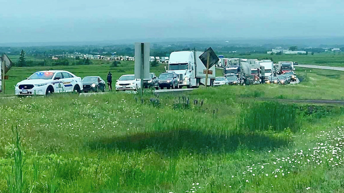 Hundreds of trucks stranded in Canada amid protest over COVID travel rules