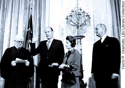 With President Johnson looking on in the East Room of the White House, Judge James Randall Durfee (left) administered the oath of office to Secretary of Transportation Alan S. Boyd on October 16, 1967. The Secretary's wife Flavil holds the Bible. (Photo: Yoichi R. Okamoto/LBJ Library Collection)