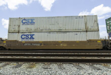 A photograph of intermodal containers on a train.