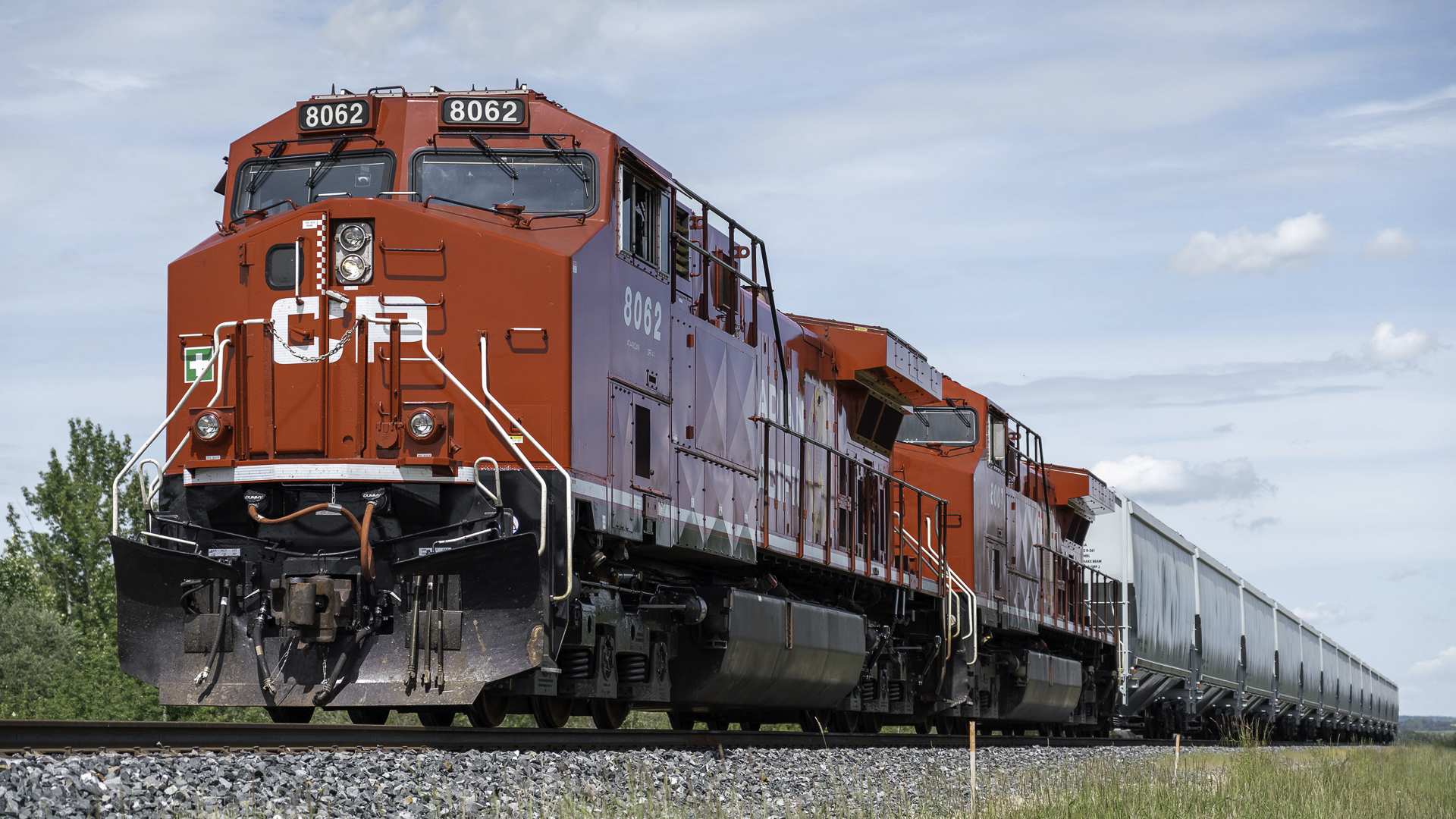 A photograph of a Canadian Pacific train on a train track.