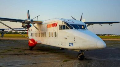Front view of an twin turboprop cargo plane.