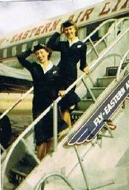 Two Eastern flight attendants on the stairs of an Eastern airplane in 1950. (Photo: thesilverliners.org)