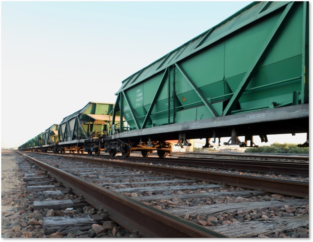 Hopper railcars sit on the tracks waiting to move. (Photo: transportation.gov)
