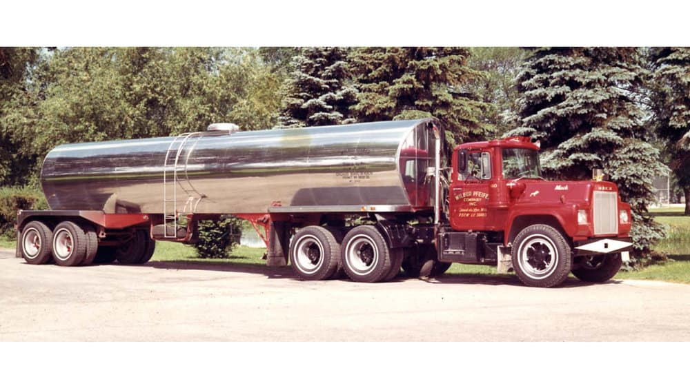 A tanker is pulled by a 1960s Mack tractor. (Photo: Mack Trucks)
