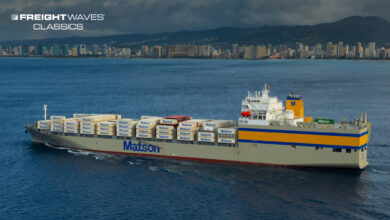 A Matson containership cruises Hawaiin waters with Honolulu in the background. (Photo: Matson)