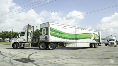 A photograph of a truck that has the Hub Group logo on it.