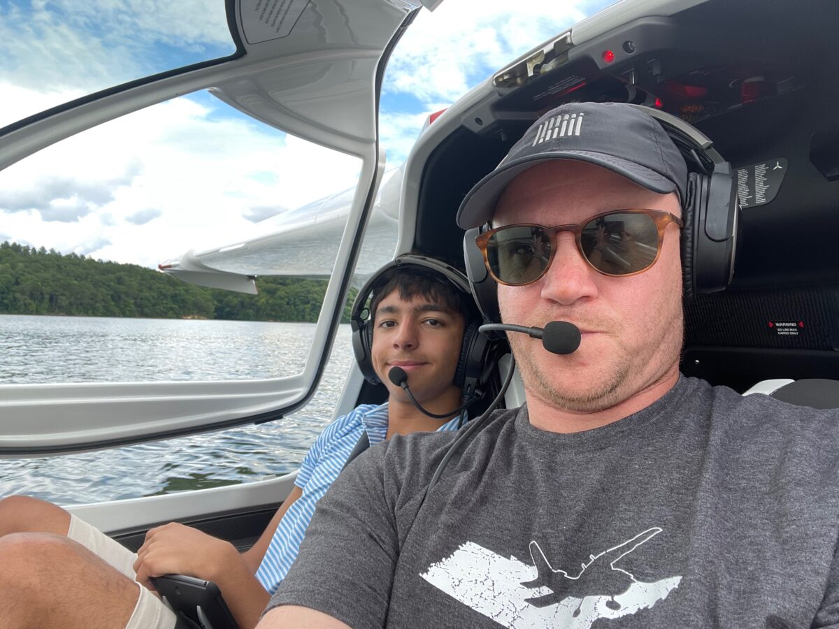 Craig Fuller with his son floating down the river in an ICON A5 floatplane