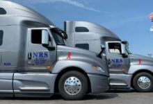 Side-by-side Nationwide Rail Services tractor-trailers.