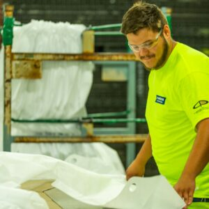 A Pro TEC-USA employee makes medical gowns in Michigan. (Photo: Pro TEC-USA)