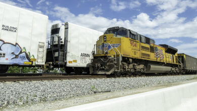 A photograph of a Union Pacific train on a train track.