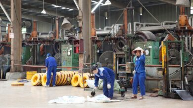 Workers in a rubber factory.
