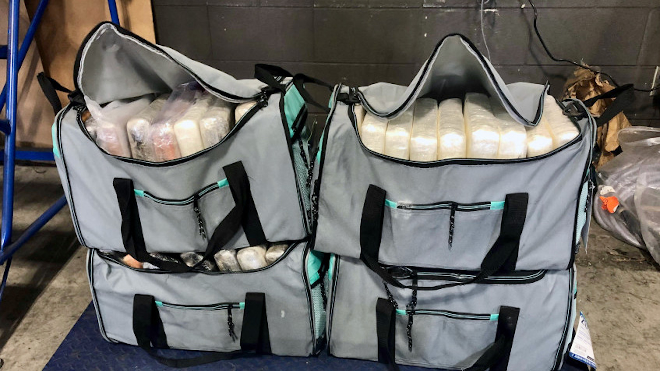 Four duffle bags filled with cocaine seized from a truck at the Canadian border.