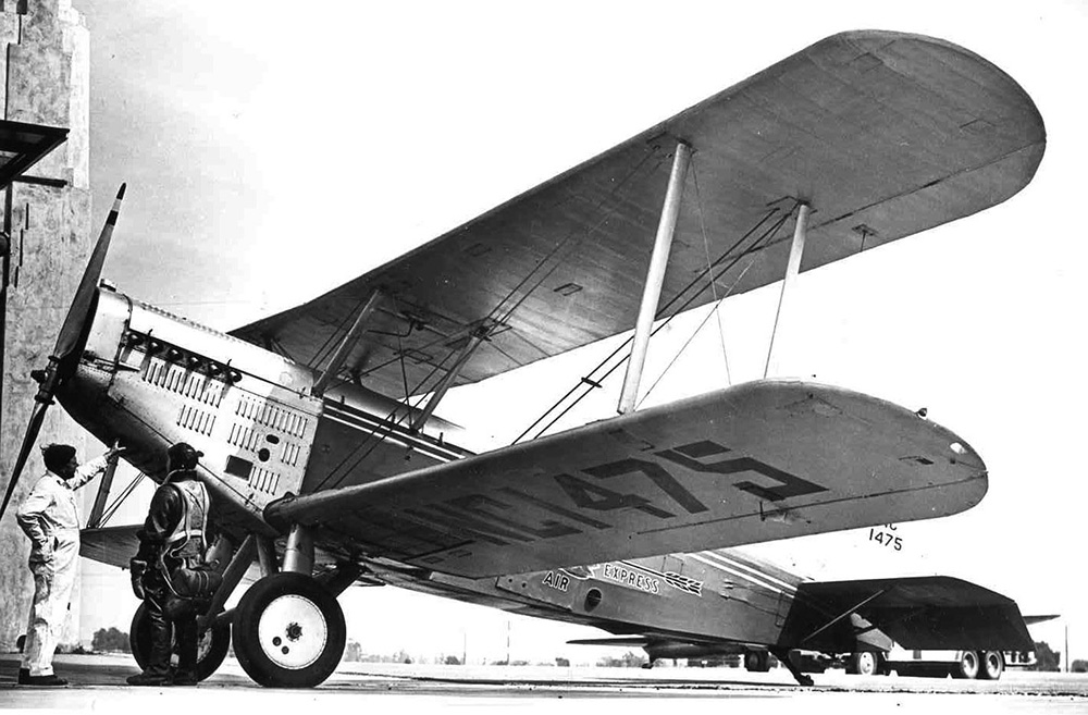 A Douglas M-4 painted in Western Air Express colors sits on runway in 1940 for reenactment of Western's 1926 air cargo flights. (Photo: National Postal Museum)
