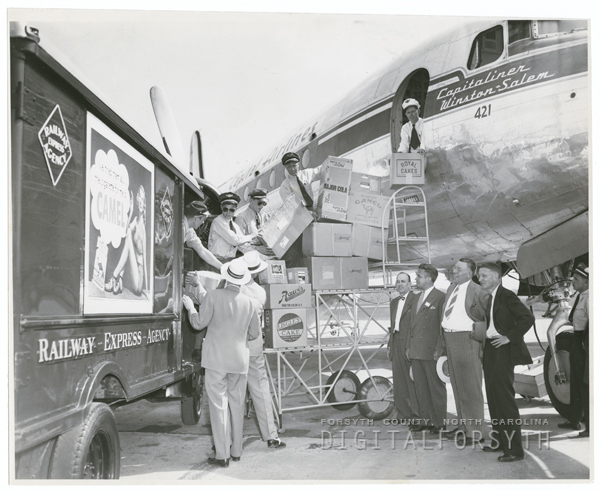 Packages shipped via Railway Express Agency being loaded on an airplane. (Photo: DigitalForsyth)