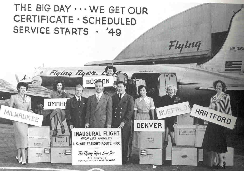 A photo of Flying Tiger Line staff celebrating the company's start of scheduled services/routes. (Photo: FlyingTigerClub.org)
