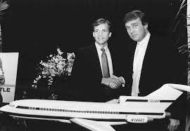 Frank Lorenzo and Donald Trump shake hands after Trump purchased the Eastern Air Lines Shuttle assets. (Photo: Texas Historical Society)