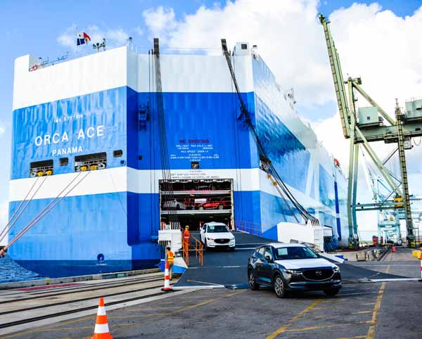 New automobiles disembark from the ship that brought them thousands of miles. (Photo: JAXPORT)