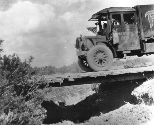 """Crossing a """"bridge"""" during the 1919 transcontinental convoy. (Photo: IN.gov)"""