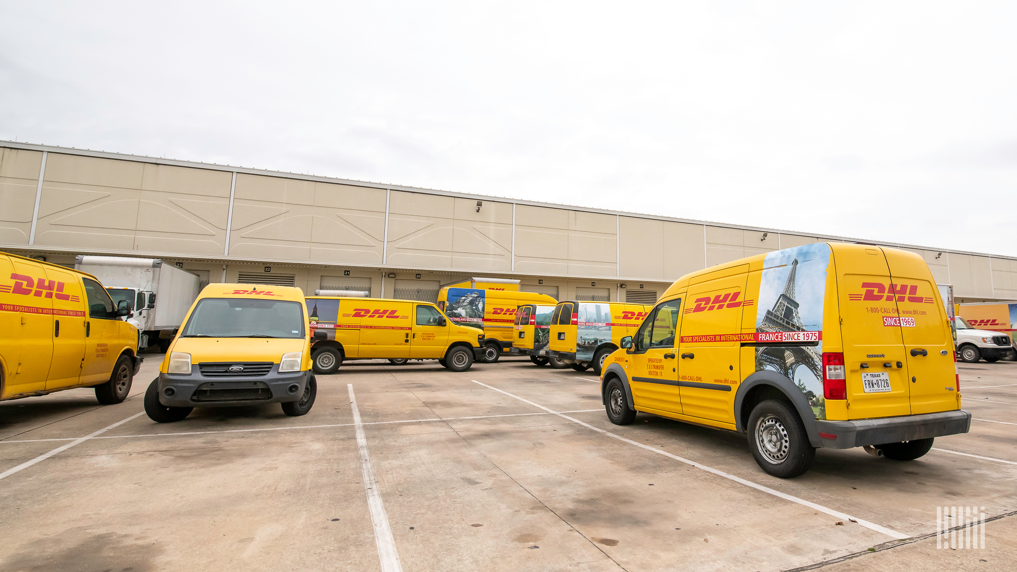 Parcel trucks outside a DHL Express facility in the U.S.
