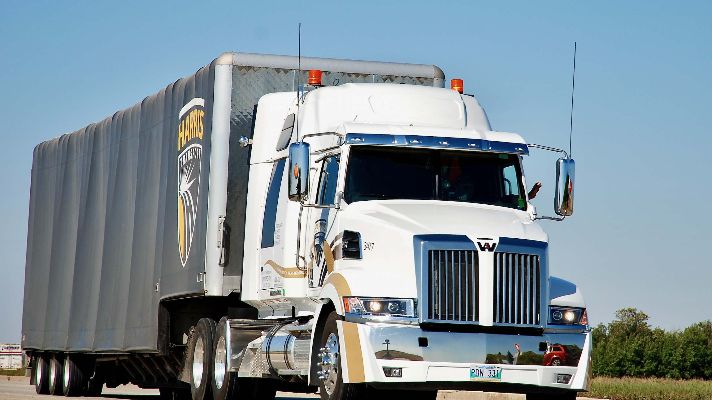 A white-tractor trailer of Harris Transport, a company recently bought by Mullen Group