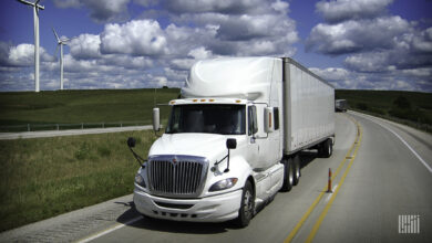 A white International ProStar truck viewed from the front as it travels on a highway to illustrate an article about the leak of data stolen from its manufacturer, Navistar.
