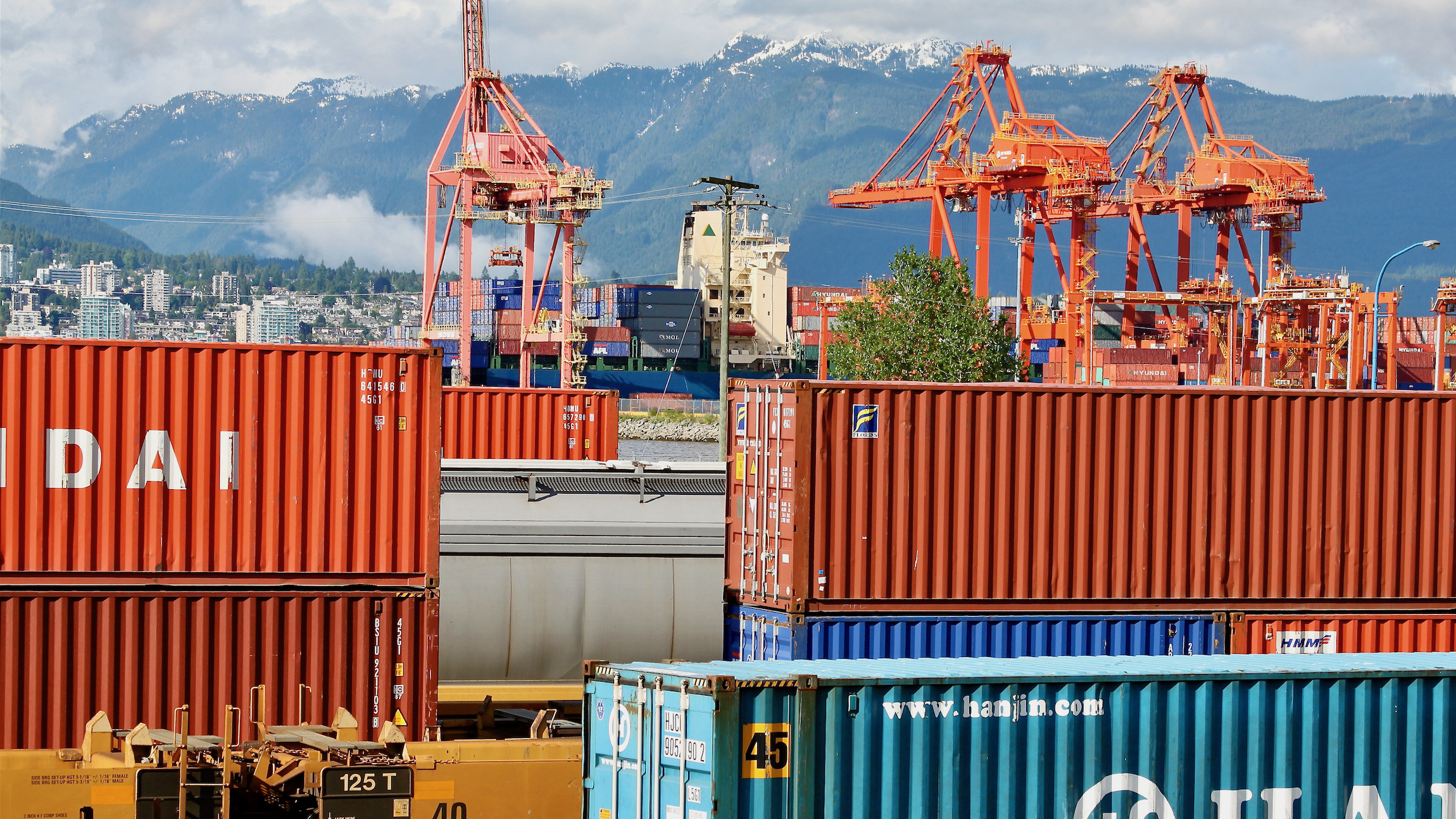 Intermodal containers on trains outside the Port of Vancouver - in the background.