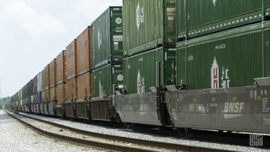 A photograph of a train hauling intermodal containers.