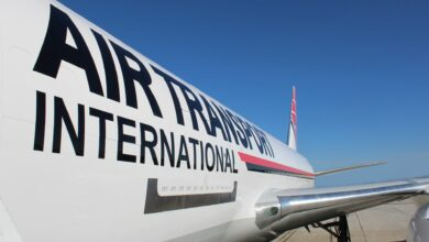 Close up side view of a white plane, with logo Air Transport International.