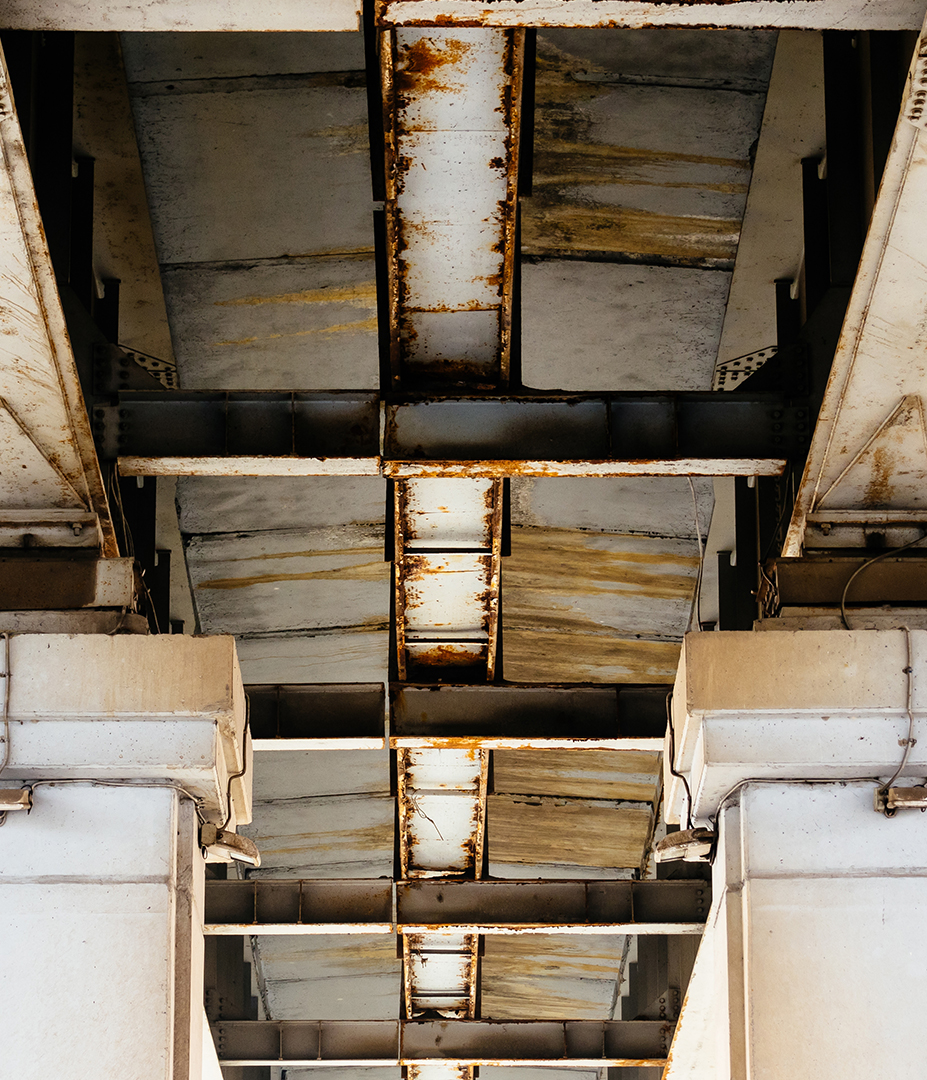The underside of a bridge has several faults. (Photo: ASCE)