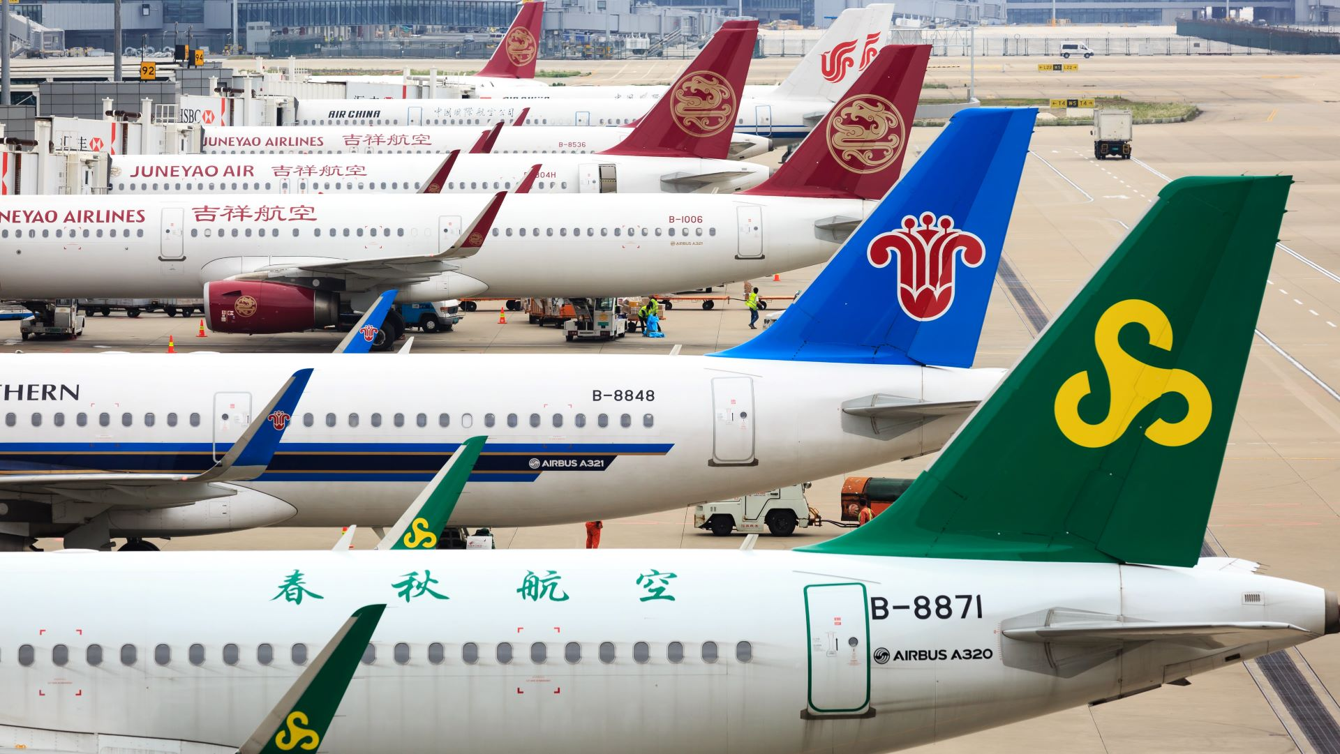 Planes parked at Shanghai Airport in a row.