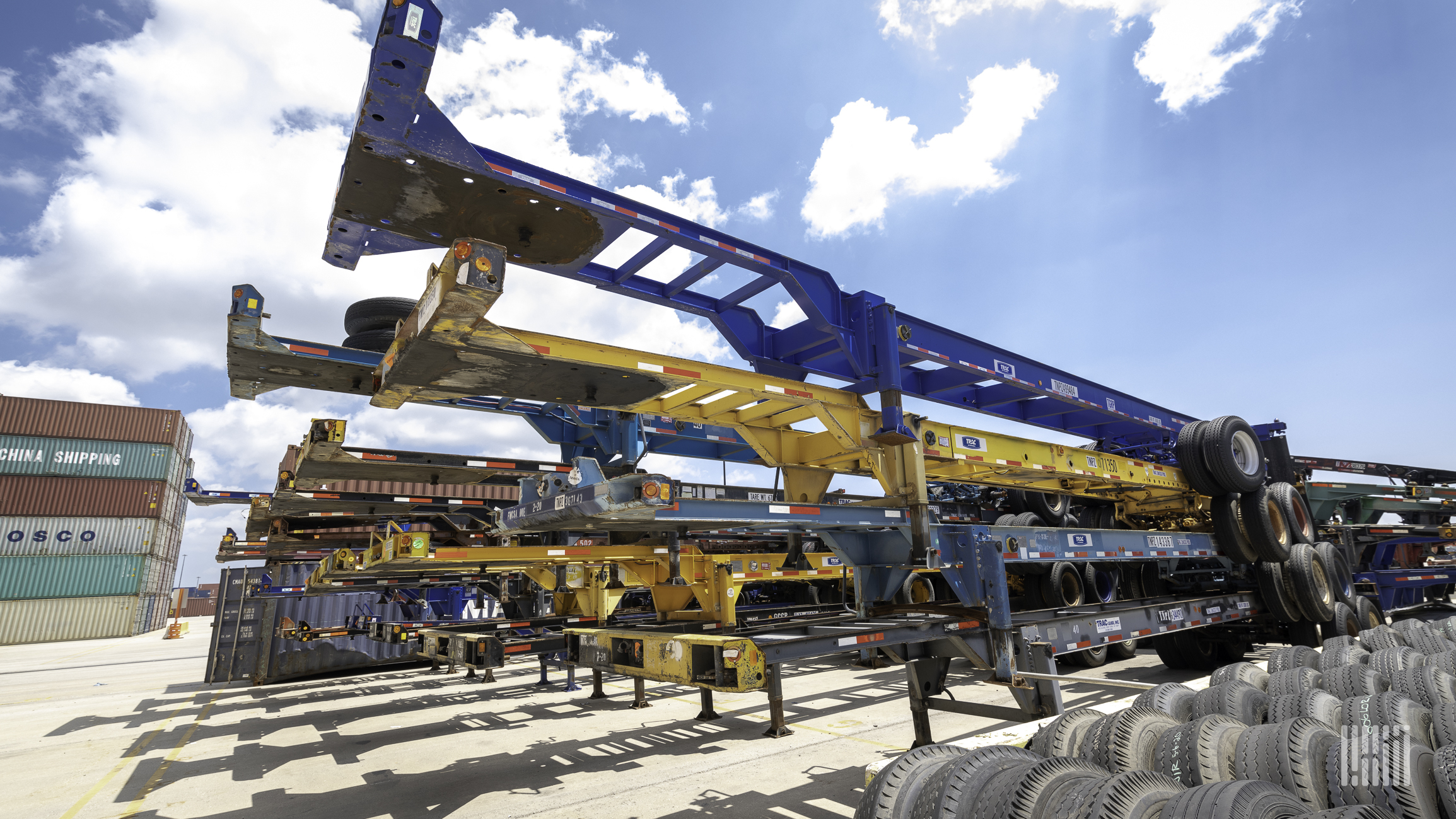 A photograph of chassis at a rail yard.