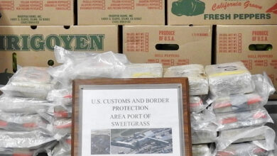 Bags of cocaine is displayed with boxes of produce seized by U.S. Customs and Border Protection officers at the Canadian border.