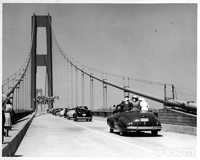 Cars and people cross the Tacoma Narrows Bridge during its grand opening ceremony on July 1, 1940.  (Photo: Washington State Department of Transportation)