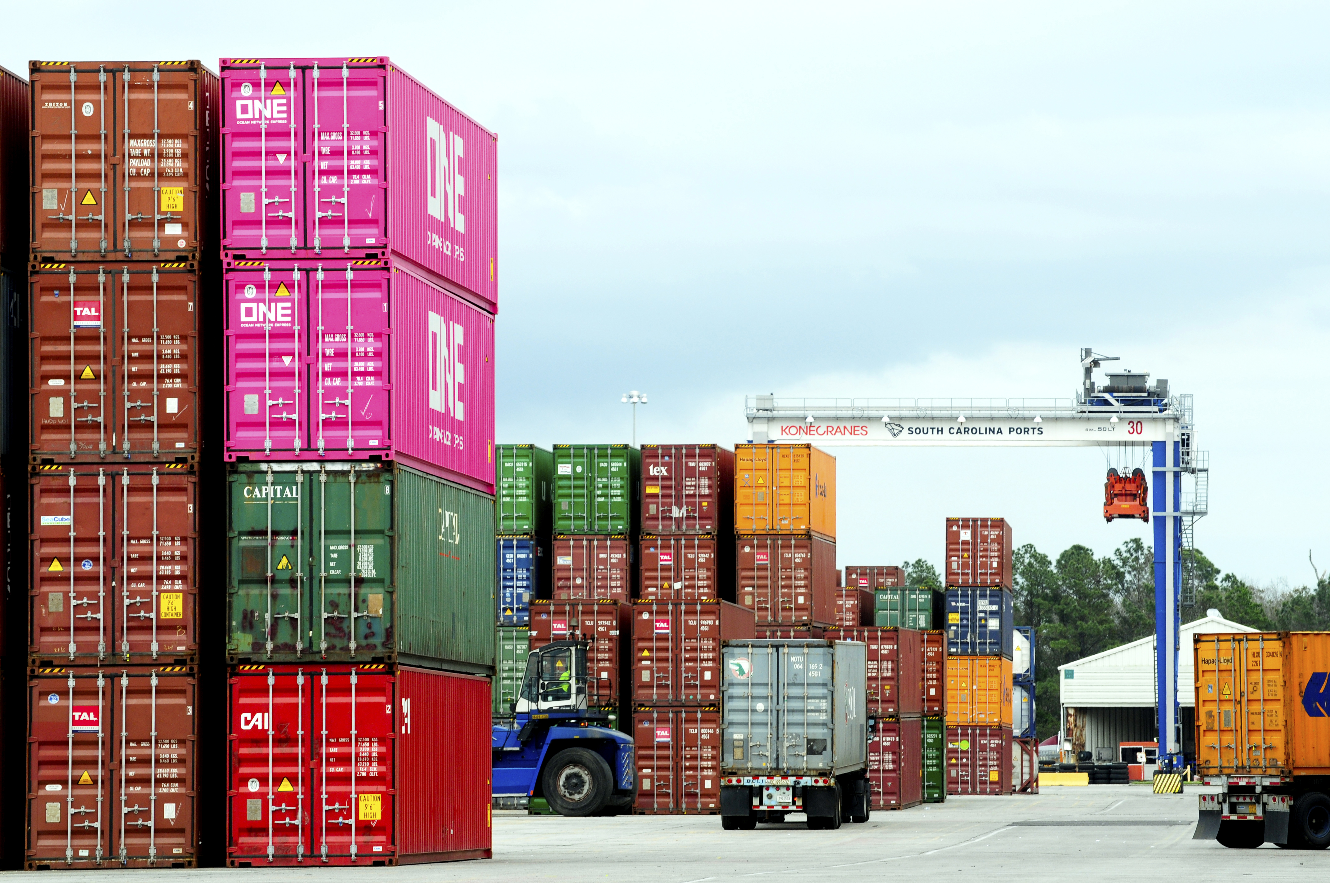 A photograph of containers stacked at a yard.