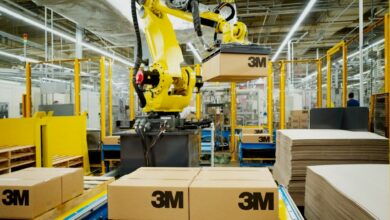 A robotic arm lifts a 3M cardboard package