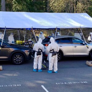 Volunteers wearing protective gear work with the Kitsap Public Health District, Washington National Guard and other community partners at a COVID-19 testing site. (Photo: Department of Health and Human Services)