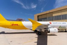 A white and gold cargo jet sporting the DHL livery.