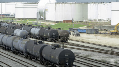 A photograph of railcars parked in a rail yard.