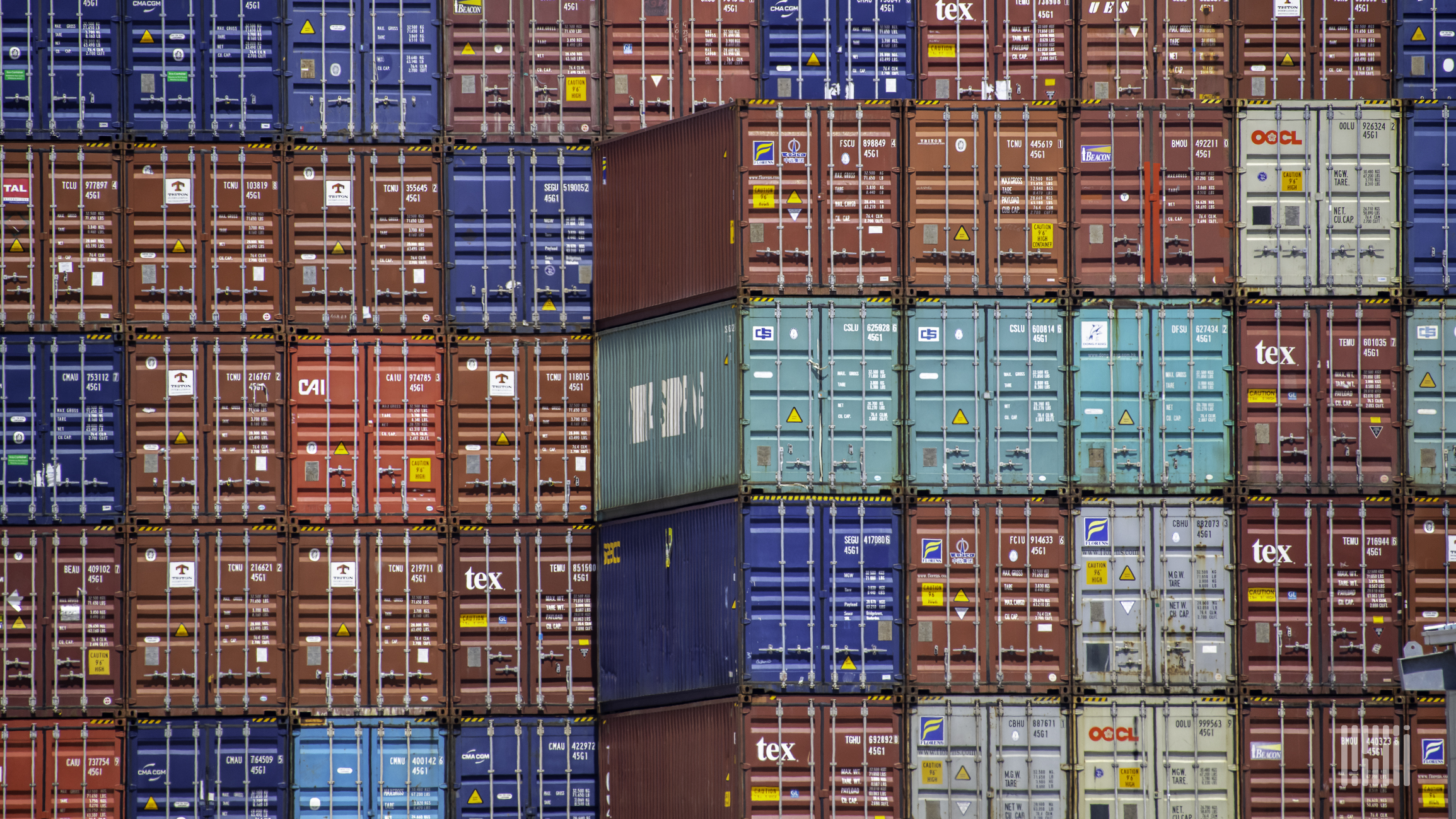 A photograph of a stack of containers.