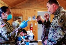 An Army sergeant instructs a service member on how to use a nasal swab for a COVID-19 screening test at Fort McCoy, Wisconsin, in August. (Photo: Department of Defense/Nicholas Nystedt)