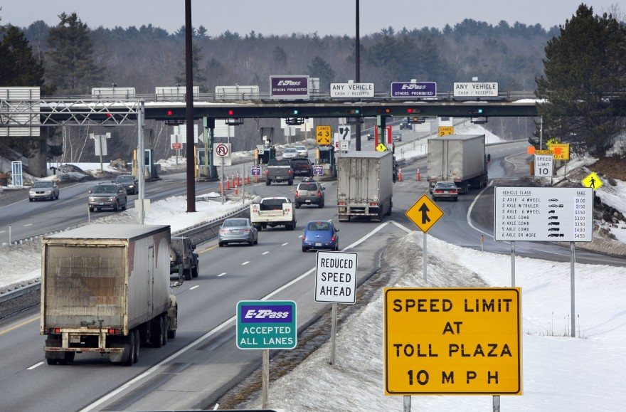 Cars and trucks approach a turnpike toll plaza. (Photo: Mainepublic.org)