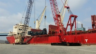 Heavy machinery being loaded onto a waiting ship. (Photo: Port Milwaukee)