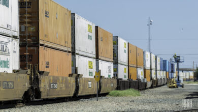 A photograph of a train hauling double-stacked intermodal containers.
