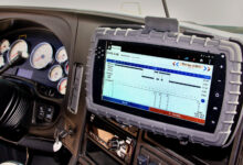 The screen of a Cab-Mate One ELD mounted inside a truck with its screen turned on. The device was recently certified in Canada.
