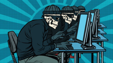 An illustration of four skeleton figures in front of computers representing hackers for an article about a ransomware attack