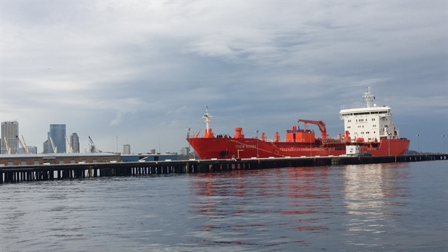 A liquid bulk carrier at anchor at Port Milwaukee with part of the city skyline in the background. (Photo: Port Milwaukee)