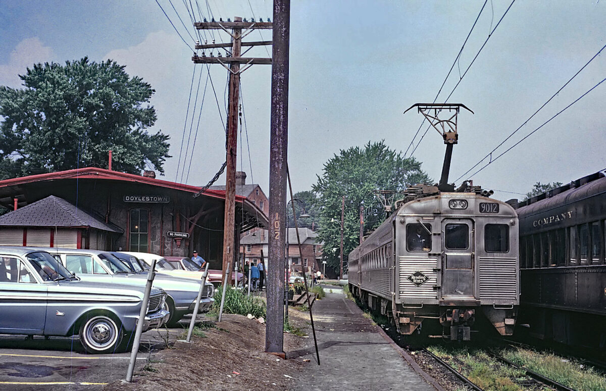 A set of Reading commuter railcars at Doylestown, Pennsylvania on August 15, 1970. The railroad operated extensive commuter services in the greater Philadelphia region. (Photo: Roger Puta/American-Rails.com)