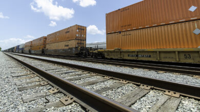 A photograph of intermodal containers on a rail track.